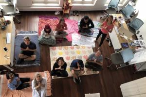 yoga and language partners up with sleek